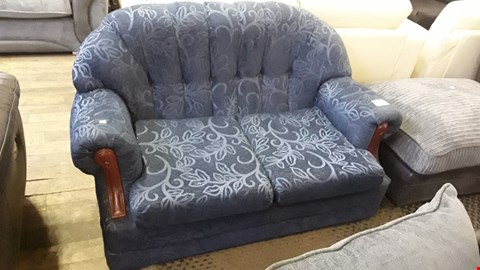 Lot 690 DESIGNER BLUE FABRIC TWO SEATER SOFA WITH EXPOSED ARM DETAIL