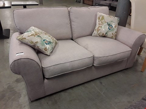 Lot 117 DESIGNER NATURAL FABRIC TWO SEATER SOFA WITH FLORAL SCATTER CUSHIONS