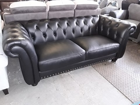 Lot 21 DESIGNER BLACK FAUX LEATHER CHESTERFIELD STYLE TWO SEATER SOFA WITH STUDDED DETAIL