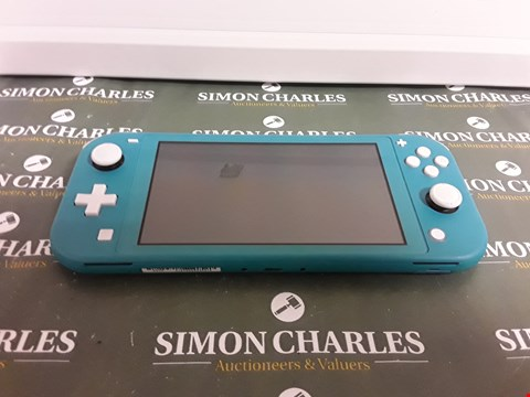Lot 2399 NINTENDO SWITCH LITE TURQUOISE CONSOLE RRP £259.99