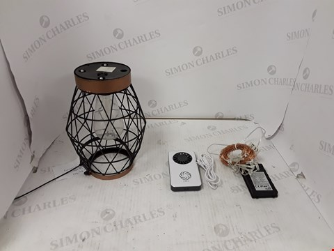 Lot 208 BOX OF A LARGE QUANTITY OF ASSORTED HOUSEHOLD ITEMS TO INCLUDE DESIGNER LANTERN, MINI FAN, STRING LIGHTS ETC