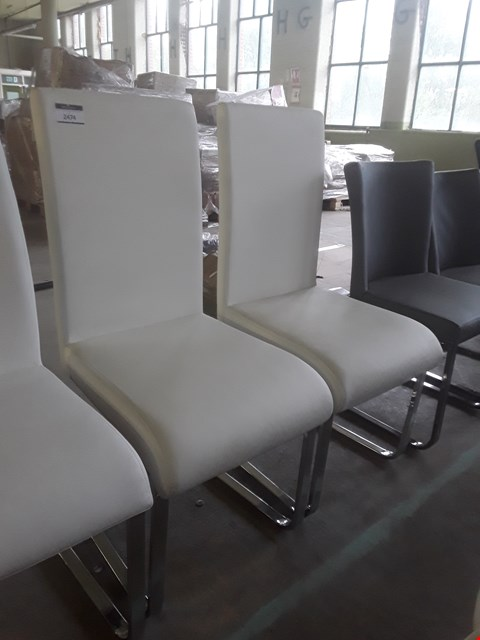 Lot 328 PAIR OF DESIGNER WHITE FAUX LEATHER ARMLESS CHAIRS ON MODERN METAL BASES