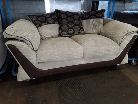 Lot 27 DESIGNER BROWN FAUX LEATHER & BEIGE JUMBO CHORD THREE SEATER SOFA WITH SCATTER CUSHIONS