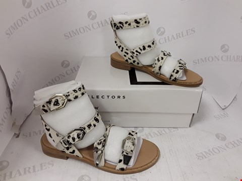 Lot 895 BOXED PAIR OF BRONX WHITE LEOPARD PRINT SANDALS SIZE 40