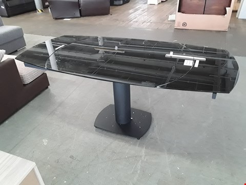 Lot 42 BOXED DESIGNER THEA BLACK GLASS SPIN EXTENDING PEDESTAL DINING TABLE ( 2 BOXES) RRP £499