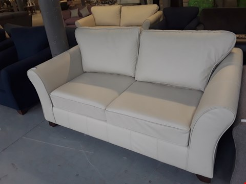 Lot 10 QUALITY BRITISH DESIGNER CREAM LEATHER 2 SEATER SOFA