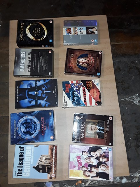 Lot 4317 4 BOXES OF ASSORTED DVDS TO INCLUDE STARGATE, LORD OF THE RINGS, XFILES