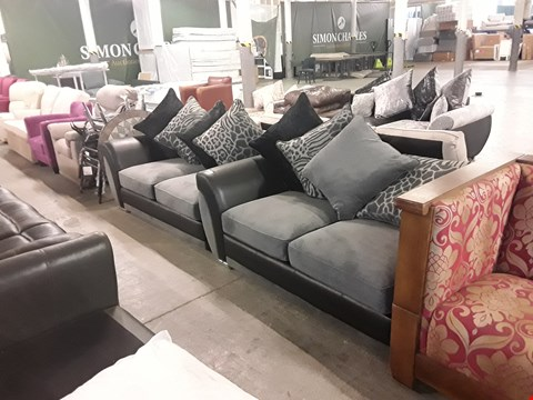Lot 197 TWO DESIGNER BLACK FAUX LEATHER AND GREY JUMBO CORD SOFA SECTIONS WITH SCATTER BACK CUSHIONS