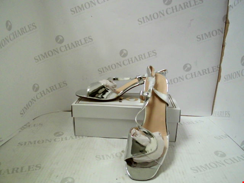 Lot 3013 PAIR OF DESIGNER JOIA WOMENS SILVER HEELS - UK SIZE 7