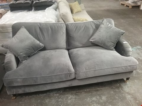Lot 1 DESIGNER SILVER FABRIC THREE SEATER SOFA ON CASTERS