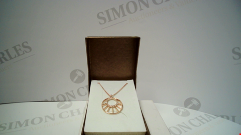 Lot 18068 DESIGNER ROSE GOLD TONE NECKLACE AND PENDANT
