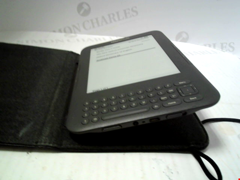 Lot 6144 AMAZON KINDLE E READER WITH LEATHER CASE