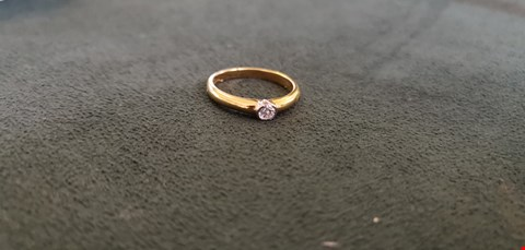 Lot 65 18CT GOLD RING RUB OVER SET WITH DIAMONDS WEIGHING +0.16CT  RRP £1100.00