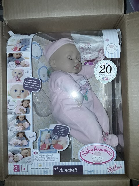 Lot 568 2 ITEMS TO INCLUDE WHITE WOOD LIT VILLAGE SCENE AND BABY ANNABELL DOLL RRP £107