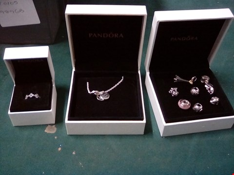 Lot 1053 3 BOXES OF PANDORA JEWELLERY INCLUDING CHARMS, RING, NECKLACE