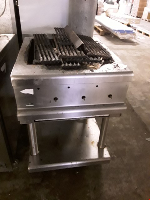 Lot 9059 COMMERCIAL STAINLESS STEEL GRIDDLE ON STAND