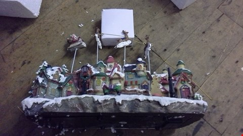 Lot 269 LED VILLAGE WITH MOVING REINDEER  RRP £65.00