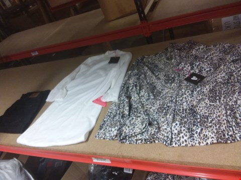 Lot 297 A BOX OF APPROXIMATELY 25 DESIGNER CLOTHING ITEMS TO INCLUDE A GIFT WRAPPED LEOPARD FLEECE PRINT PJ SET, A PAIR OF RELAXED RIPPED MOM JEANS & A WHITE FLUTED SLEEVE DRESS