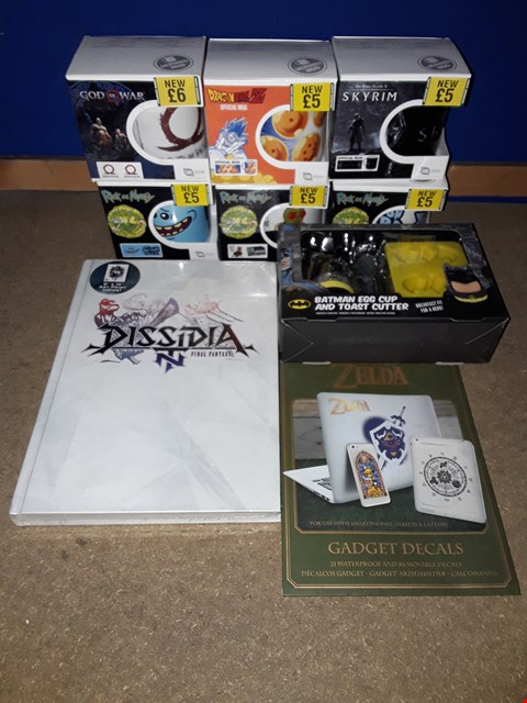 Lot 2238 BOX OF APPROXIMATELY 27 ASSORTED ITEMS TO INCLUDE DISSIDIA FINAL FANTASY NT COLLECTOR'S EDITION GUIDE, BATMAN EGG CUP & TOAST CUTTER, GOD OF WAR MUG