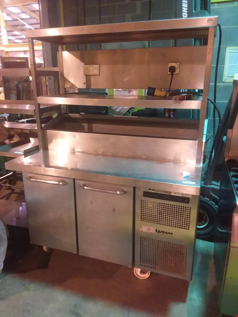 Lot 4016 GRAM STAINLESS STEEL FOOD PREPARATION UNIT WITH POWEREDSHELVING AND UNDER COUNTER FRIDGE