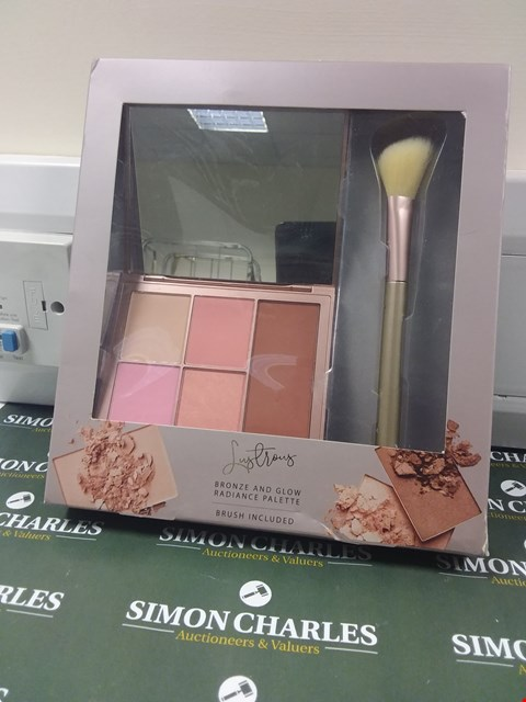 Lot 200 BOXED LUSTROUS BRONZE AND GLOW RADIANCE PALETTE WITH BRUSH