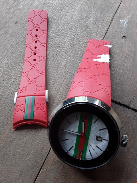 Lot 138 DESIGNER GUCCI STYLE WRIST WATCH ON RED STRAP  (STRAP DETACHED)