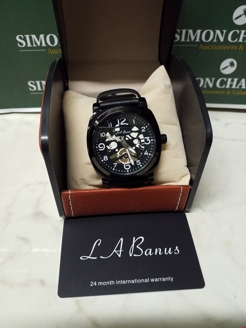 Lot 4559 L. A BANUS BLACK STAINLESS STEEL SKELETON WATCH WITH BLACK LEATHER WRIST STRAP