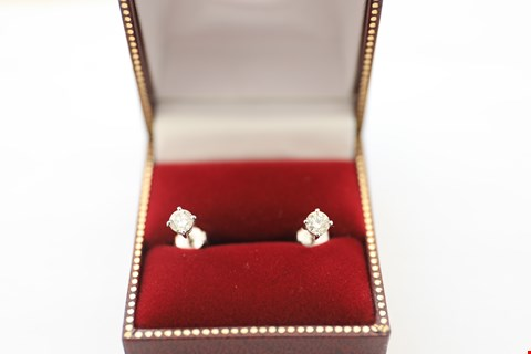 Lot 27 18CT WHITE GOLD STUD EARRINGS EARRINGS SET WITH DIAMONDS WEIGHING +-0.62CT