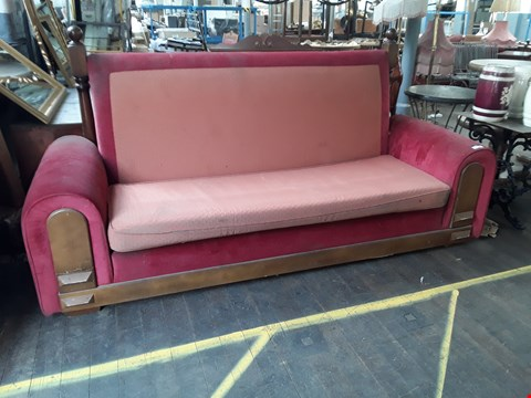 Lot 5008 DESIGNER RED FABRIC UPHOLSTERED HIGH BACK FOUR SEATER SOFA