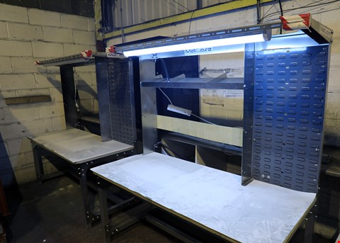 Lot 4010 BRAND NEW METLASE STAINLESS STEEL FABRICATED POWERED WORK BENCH WITH LIGHTING.