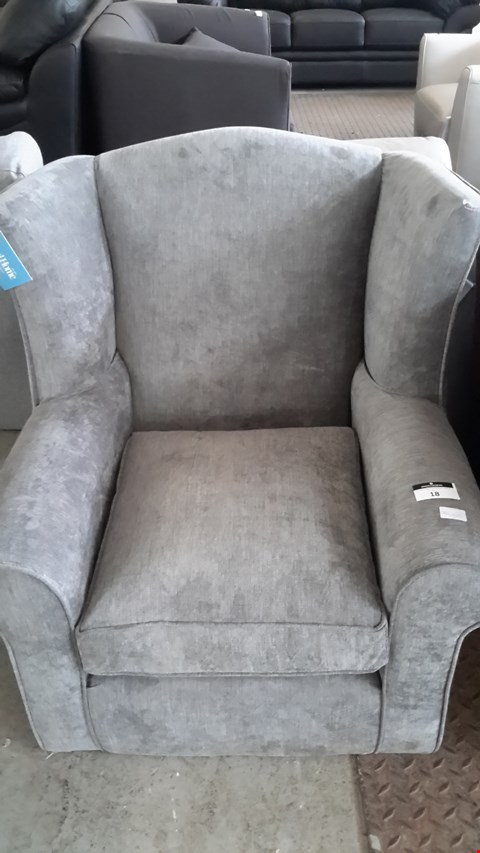 Lot 18 DESIGNER GREY FABRIC WING BACK ARMCHAIR