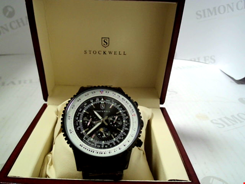 Lot 3295 DESIGNER STOCKWELL AUTOMATIC WATCH, MOONPHASE DIAL FOR AM/PM INDICATOR STAIINLESS STRAP. GLASS BACK RRP £625.00