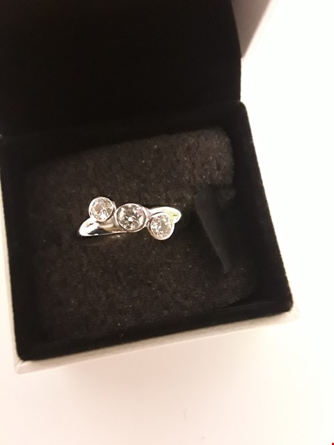 Lot 279 18CT WHITE GOLD THREE STONE RING RUBOVER SET WITH DIAMONDS WEIGHING +/- 0.5CT