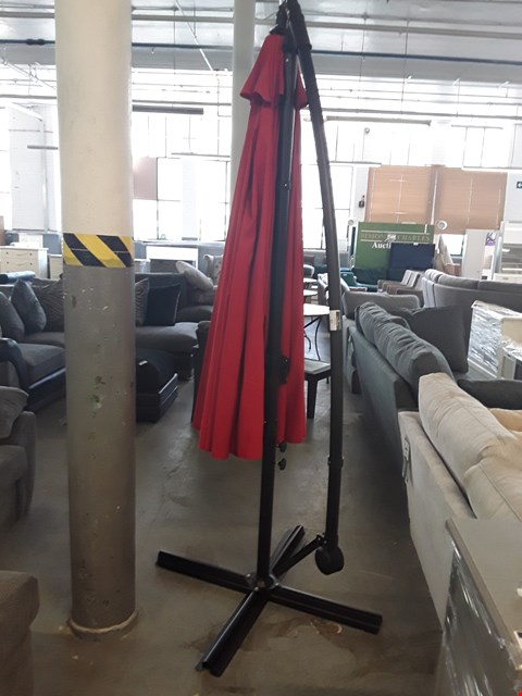 Lot 67 DESIGNER RED FABRIC AND BLACK METAL CANTILEVER PARASOL
