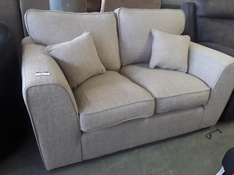 Lot 81 DESIGNER NATURAL FABRIC TWO SEATER SOFAWITH SCATTER CUSHIONS