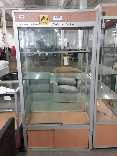 Lot 1048 TALL GLAZED DISPLAY CABINET ON CUPBOARD BASE