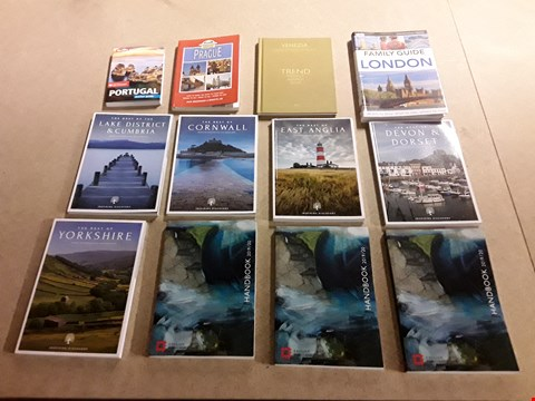 Lot 492 LOT OF APPROXIMATELY 12 ASSORTED GUIDEBOOKS AND HANDBOOKS TO INCLUDE BERLITZ PORTUGAL POCKET GUIDE, INSPIRING DISCOVERY THE BEST OF EAST ANGLIA, THE ENGLISH HERITAGE 2019/20 HANDBOOK ETC