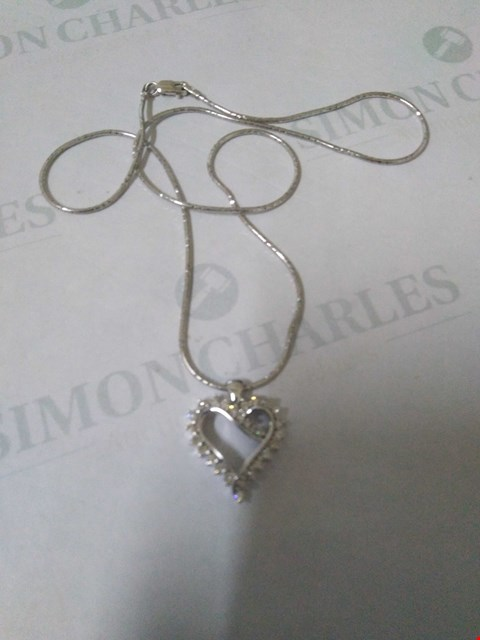 Lot 44 18CT WHITE GOLD HEART SHAPED PENDANT ON CHAIN SET WITH DIAMONDS WEIGHING +0.52CT RRP £3000.00
