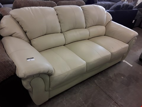Lot 86 DESIGNER CREAM FAUX LEATHER THREE SEATER SOFA