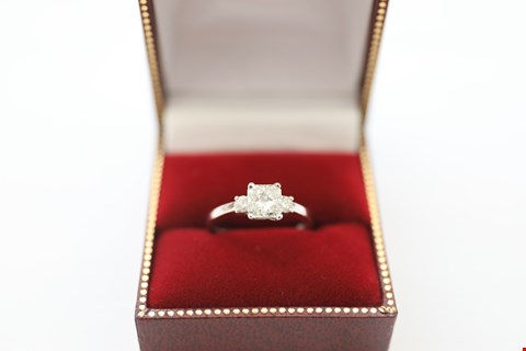 Lot 28 18CT WHITE GOLD RING SET WITH A RADIANT CUT DIAMOND AND ROUNG TO SHOULDERS. TOTAL WEIGHT +-1.30CT