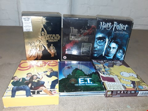 Lot 4147 JOB LOT OF ASSORTED CD/DVD BOXSETS , BOOKS AND GAMES TO INCLUDE E.T, HARRY POTTER, GLEE(4 BOXES)