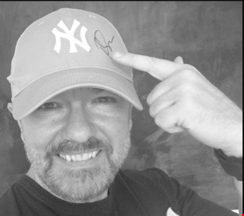 Lot 3 RICKY GERVAIS SIGNED BASEBALL CAP.