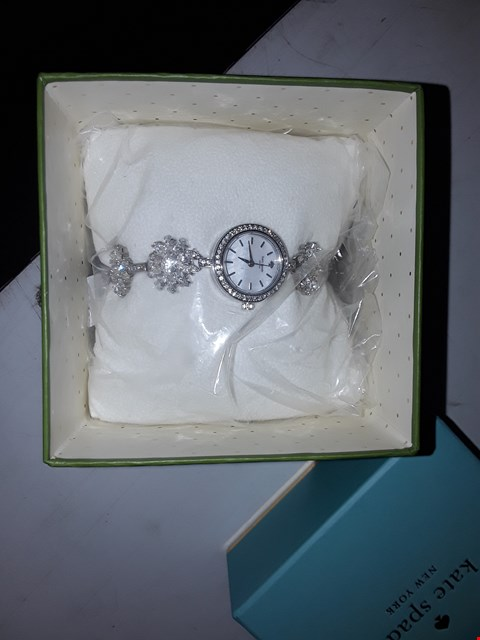 Lot 3040 KATE SPADE MOTHER OF PEARL AND SILVER DIAL DAISY CHAIN BRACELET LADIES WATCH RRP £319.00