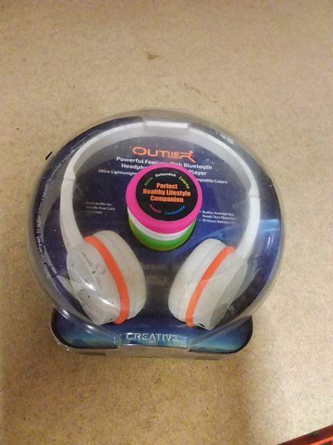 Lot 8257 CREATIVE OUTLER ULTRA-LIGHTWEIGHT 4 WAY MUSIC PLAYBACK CHANGEABLE COLOURS HEADPHONES