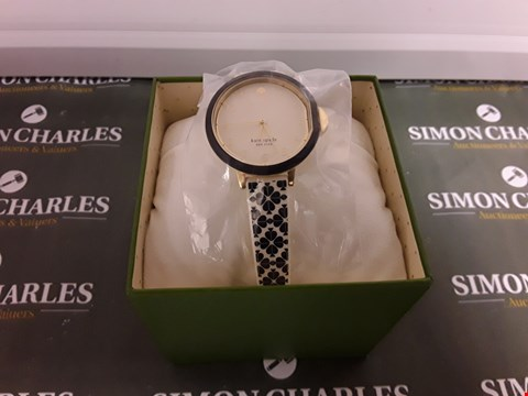 Lot 1301 KATE SPADE NEW YORK SILVER SUNRAY AND GOLD DETAIL DIAL WHITE AND BLACK SPADE PRINT SILICONE STRAP LADIES WATCH RRP £185.00