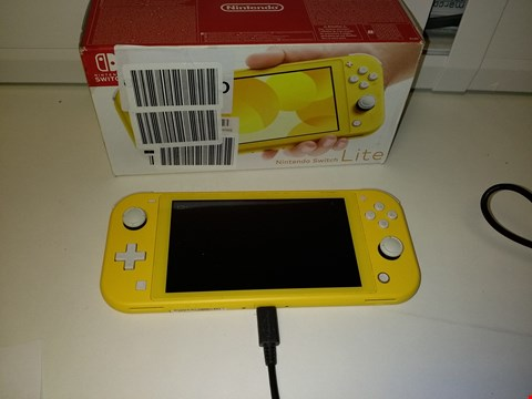 Lot 2186 NINTENDO SWITCH LITE CONSOLE - YELLOW WITH LUIGI'S MANSION 3 SWITCH GAME RRP £329.99