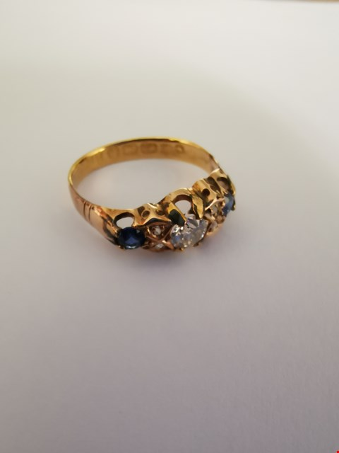 Lot 227 18CT GOLD RING SET WITH DIAMONDS AND BLUE STONES.  TOTAL WEIGHT +/-0.32CT