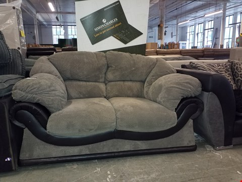 Lot 37 DESIGNER BLACK FAUX LEATHER/GREY DOTTED FABRIC 2 SEATER SOFA