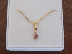 Lot 1 RUBY AND DIAMOND GOLD PENDANT SET 9 CARAT