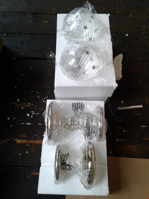 Lot 85 A SET OF 2 CLEAR BAUBLES AND A PAIR OF SILVER ORNAMENTS